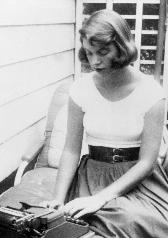 Photo of Sylvia Plath typing