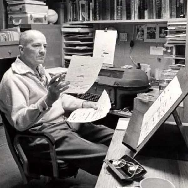 Photo of Robert A. Heinlein revising his writing.