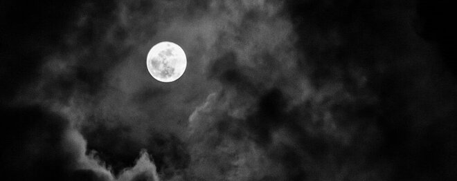 Mysterious moon in the clouds